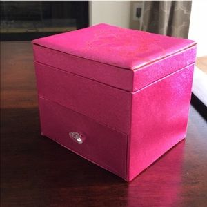 Pink satin jewelry box filled with jewelry